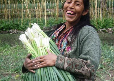 Woman from Tierra Linda, Aldea Sacsiguan shows, while the work may be grueling, a little fun can be had as well.