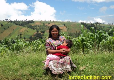 This woman from Patzún breast-feeds her daughter with Chuiquel in background. She is from Mocolic Xot, however. Patzún has several poor rural communities, but none poorer than Mocolic Xot.