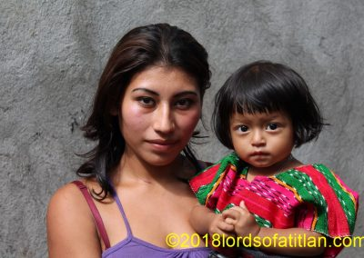 Although this mother from Samayac looks like an Italian film star, her daughter looks pure Maya.