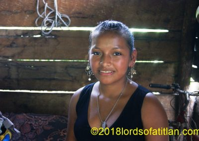 Rosa's home is rustic and her life is hard, however she smiles.