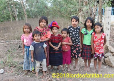 Only one girl  wears native dress.in this photograph of La Nueva Cajolá Champerico, but if they could afford it, they all would.