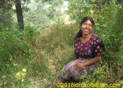 "Woman from San Andrés Semetabaj seated in the weeds. We call people from San Andrés""¨Trixana""."