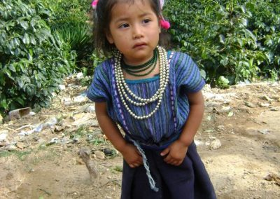 Little girl from Chutulul, San Antonio Palopó. Although she wears the clothing of her municipality, San Antonio, Chutulul is likewise more related culturally to San Lucas, Sololá and Patzún.