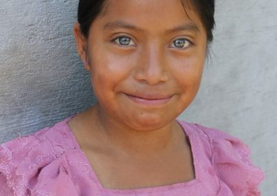 Although this girl from Sector La Palma, San Lucas Tolimán has eyes bluer than mine, she´s not mine. Although they still call her sector, La Palma, they cut down the palm years ago.