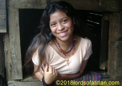 Her home is rustic and poor, but look at how Dorcas of Aldea Xejuyú, San Lucas Tolimán smiles.