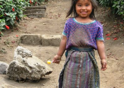 This girl is from San Martín, San Lucas Tolimán but wears a huipil of San Antonio Palopó. Huipiles from many parts can be prohibitively expensive, but those from San Antonio are affordable. They are made on floor loom and therfore inexpensive.