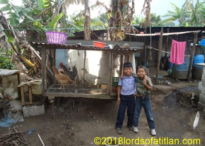Boys with chickens in Panimaquip, San Lucas Tolimán