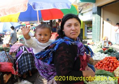 Eddy is big now, but here he is on the back of his mother, a vegetable vendor from Xecaracoj, an aldea of Xela.
