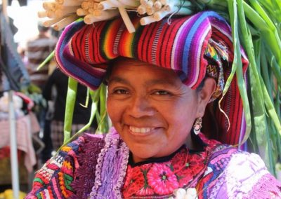 This woman from Almolonga has her own sales stall but mostly walks through the market offering her products.