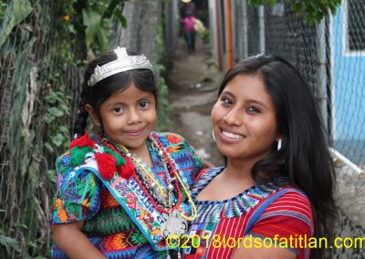 The woman holding Jennifer is from San Juan la Laguna and therefore speaks tzutujil. She was not an indigenous queen,however. She holds the indigenous queen of San Andrés Iztapa, who speaks kaqchiquel very well.