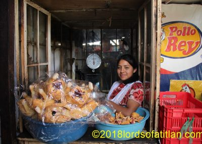 I think she is from Cantel, Quetzaltenango, but I'm sure her blouse is. One thing's for certain, however. Therei's no food more dear to the Guatemalan heart than chicken.