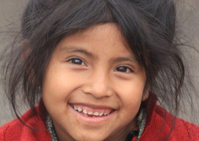 This flower girl from Las Majadas is so sweet, yet, like many of her townspeople so desperately poor.