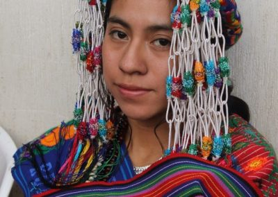 She is an Indigenous queen of Parramos,  Chimaltenango and so speaks kaqchiquel.