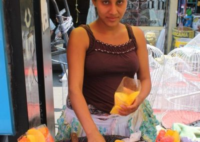 Norma from San Sebastián sells fruit in Xela. Meanwhile, her sister Noemi sells in San Pedro la Laguan.