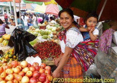 Child on mother's back in the Demo (la Democracia).