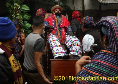 Spiritual guides from different regions bear Aloc Mam in his fiesta October 28th in Zunil. However, he wears clothing from San Pedro la Laguna, Sololá.